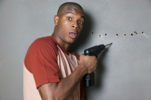 Man drilling holes in wall